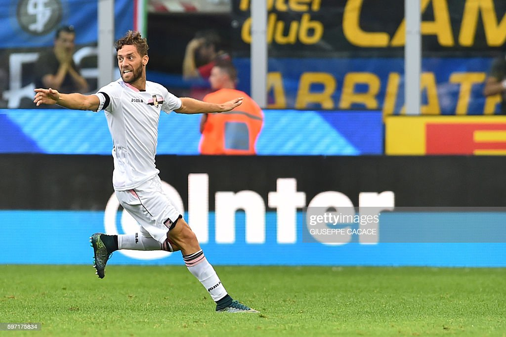 Palermo's defender from Italy Andrea Rispoli celebrates after scoring a goal during the Italian Serie A football match Inter Milan vs Palermo at 'San...