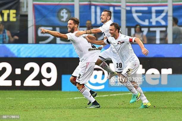 Palermo's defender from Italy Andrea Rispoli celebrates after scoring a goal with Palermo's midfielder Illija Nestorovski and Palermo's defender from...
