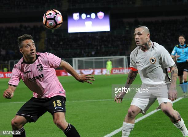 Palermo's defender Thiago Cionek vies with Roma's midfielder from Belgium Radja Nainggolan during the Italian Serie A football match Palermo vs AS...