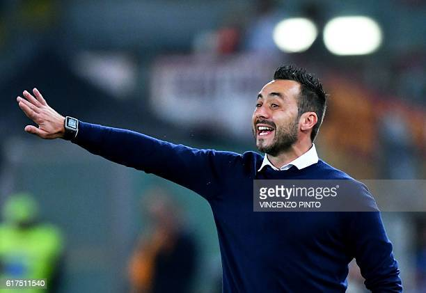 Palermo's Italian coach Roberto De Zerbi gestures during the Serie A football match AS Roma vs Palermo at the Olympic stadium in Rome on October 23...