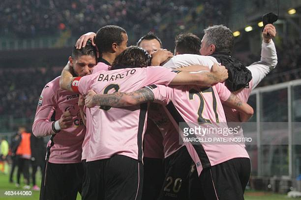 Palermo's Luca Rigoni is congratulated by his teammates after scoring during the Italian Serie A football match Palermo vs Napoli on February 14 2015...