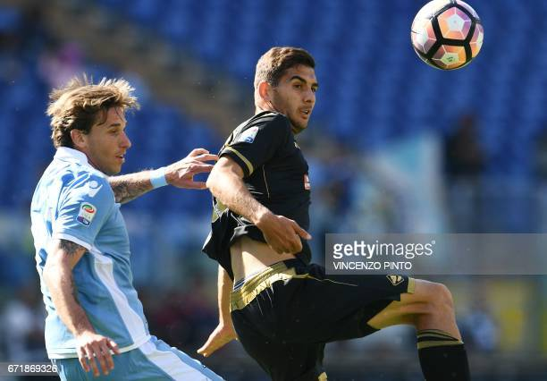 Palermo's midfielder from Bulgaria Ivaylo Chocev vies with Lazio's midfielder from Argentina Lucas Biglia during the Italian Serie A football match...