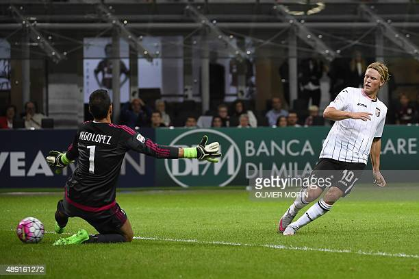 Palermo's midfielder from Sweden Oscar Hiljemark scores past AC Milan's goalkeeper from Spain Diego Lopez during the Italian Serie A football match...