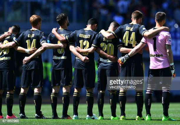 Palermo's player stand a minutes silence for Michele Scarponi the 2011 Giro dItalia winner who was killed while cycling near his home yesterday...