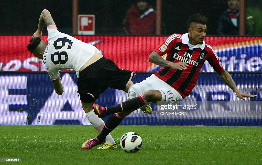 Palermo's Swiss defender Michel Morganella (L) fights for the ball with AC Milan's Ghanaian defender Prince Kevin Boateng during the serie A match between AC Milan and Palermo, on March 17, 2013 in Milan, at the San Siro stadium.