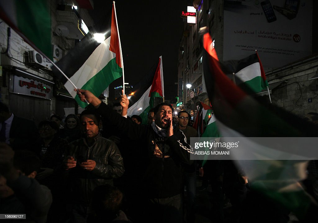 Palestenian protesters shout slogans as they march in the West Bank city of Ramallah on November 14, 2012 during a demonstration in support of the people of the Gaza Strip and against Israeli air strikes. Israel killed a top Hamas military commander in a targeted air strike in Gaza, prompting outrage from Palestinian militants who said the Jewish state had opened 'the gates of hell.'