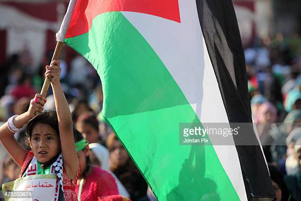 Palestian refugees attend a rally organized by the Muslim Brotherhood to mark the 67th anniversary of the 'Nakba' day at a refugee camp May 15 2015...