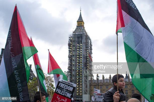 Palestine flags are pictured against the backdrop of the Big Ben during a demonstration in London on November 4 2017 The demonstration was organized...