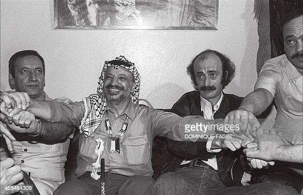 Palestine Liberation Organisation chairman Yasser Arafat shown in a picture dated 30 August 1982 in Beirut shakes hands with his Lebanese supporters...