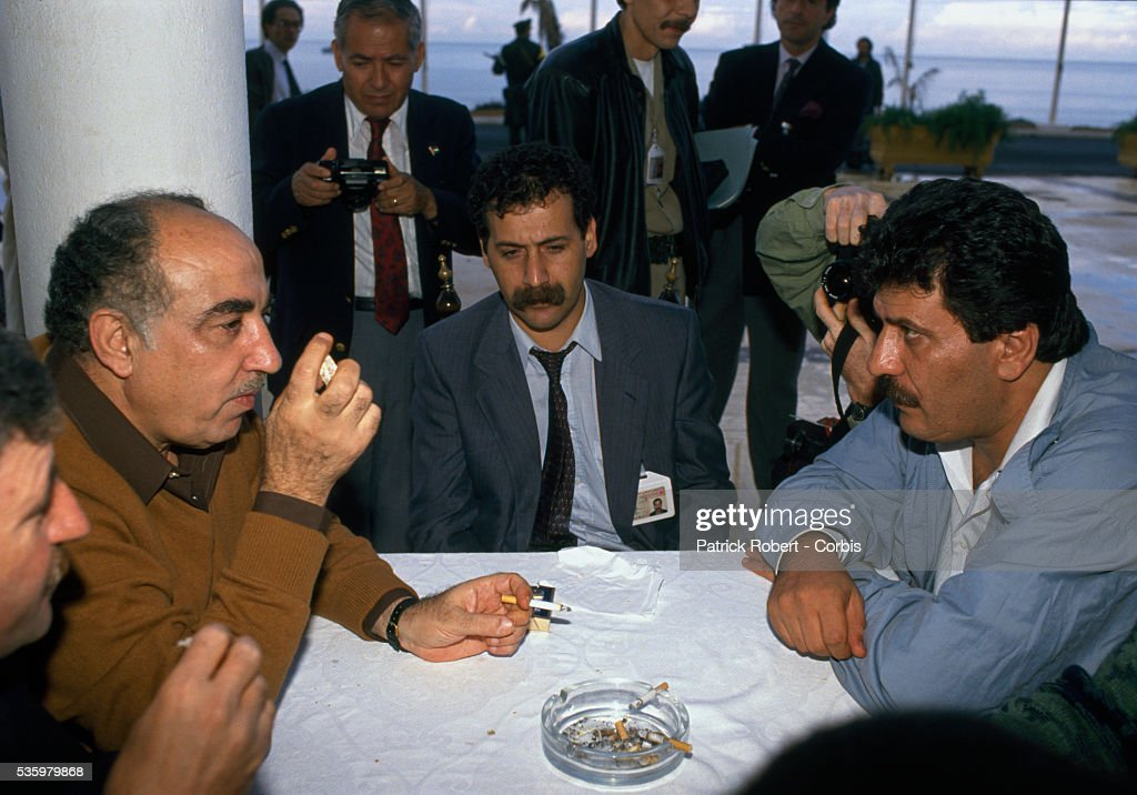 Palestine Liberation Organization leader Abu Iyad talks with Palestinian Liberation Front leader and terrorist Abul Abbas during the 19th session of the Palestinian National Council. The PLO proclaimed the state of Palestine, acknowledged resolutions 181, 242, and 338, and condemned terrorism during the meeting.