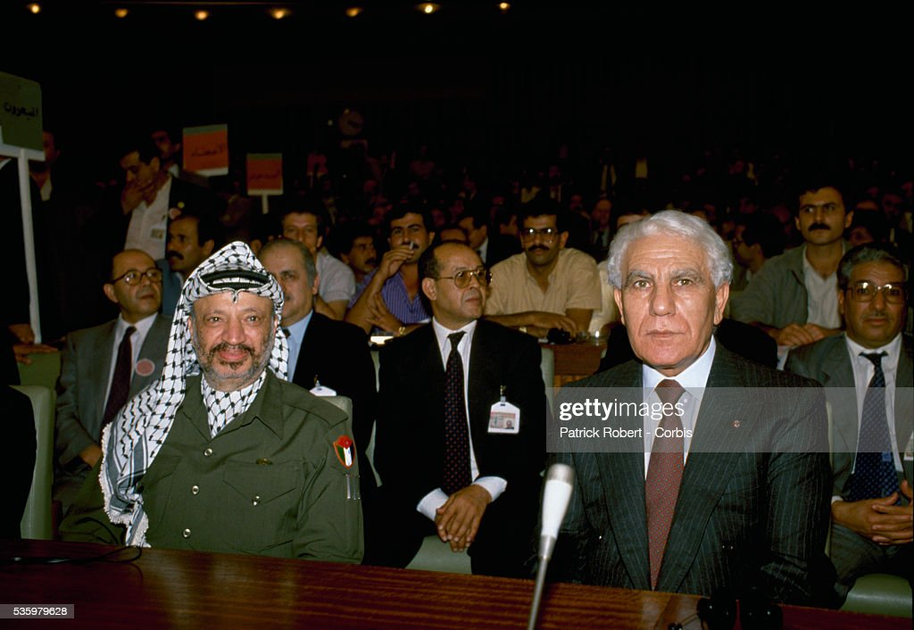 Palestine Liberation Organization leader Yasser Arafat and Algerian President Chadli Bendjedid attend the 19th session of the Palestinian National Council. The PLO proclaimed the state of Palestine, acknowledged resolutions 181, 242, and 338, and condemned terrorism during the meeting.