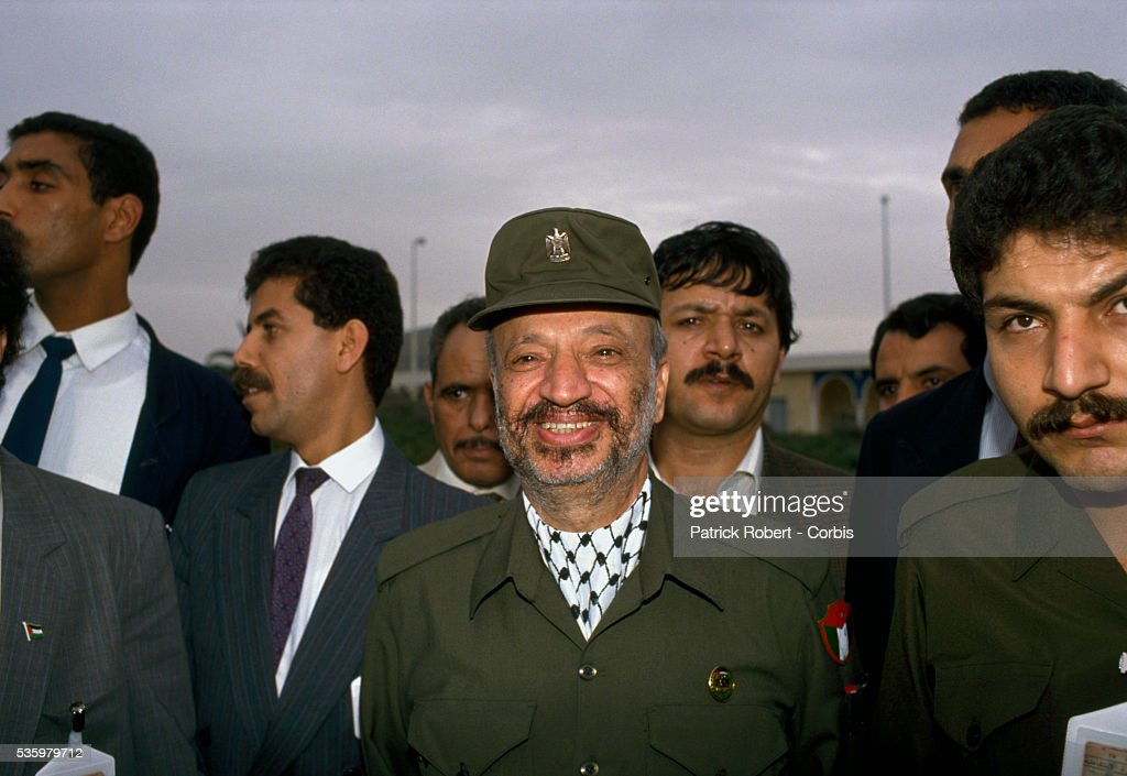 Palestine Liberation Organization leader Yasser Arafat arrives at the 19th session of the Palestinian National Council. The PLO proclaimed the state of Palestine, acknowledged resolutions 181, 242, and 338, and condemned terrorism during the meeting.