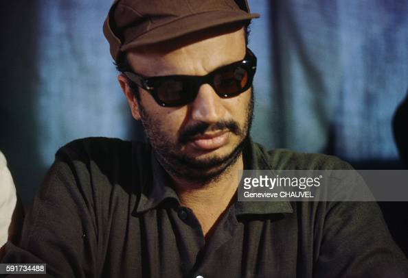 Palestine Liberation Organization leader Yasser Arafat attends a press conference in Jordan where he set up Palestinian refugee camps and bases for...