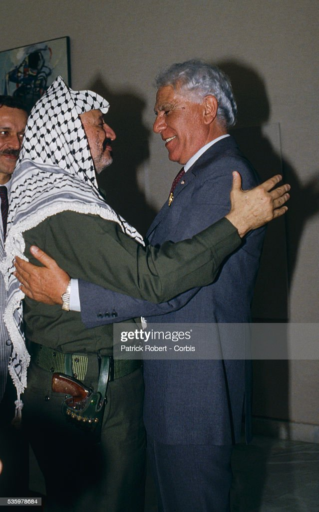 Palestine Liberation organization leader Yasser Arafat hugs Algerian President Chadli Bendjeddid at the close of the Algiers Summit, during which Arab leaders pledged major cash contributions of $10 million per month, to be administered by the Palestine Liberation Organization, to the Palestinian uprising. The summit initially convened to decide handing leadership of the AMU to Qaddafi and amending the constitution to make it possible for decisions to be taken by majority vote in order to avoid the deadlock. The Algiers Summit was the first North African summit to include political leaders from Morocco, Algeria, Tunisia, Libya, and Mauritania.