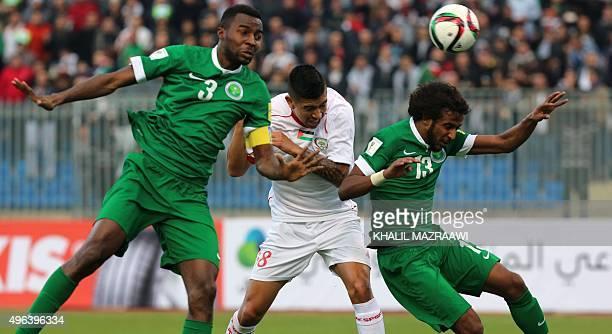 Palestine's forward Jonathan Zorrilla fights for the header with Saudi Arabia's defender Osama Hawsawi and Yasir alShahrani during their AFC...