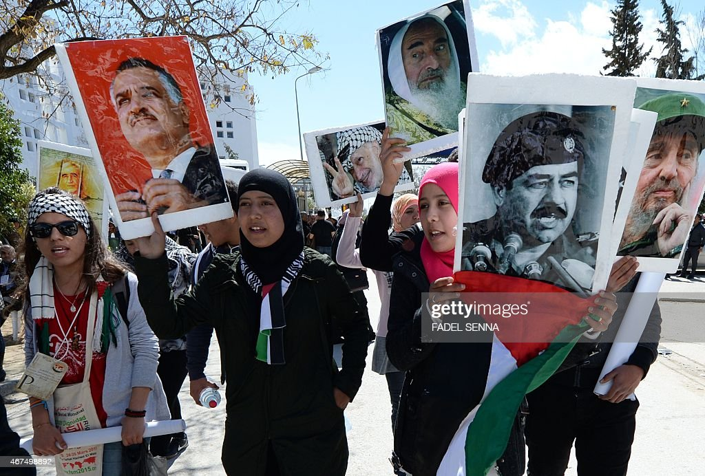 Palestinian activists hold portraits of Ahmed Saadat the secretary general of the Popular Front for the Liberation of Palestine late Egyptian...