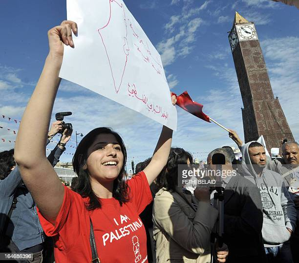 A Palestinian activists takes part in a global anticapitalist event to demand a more just world order in the center of Tunis after the opening of the...