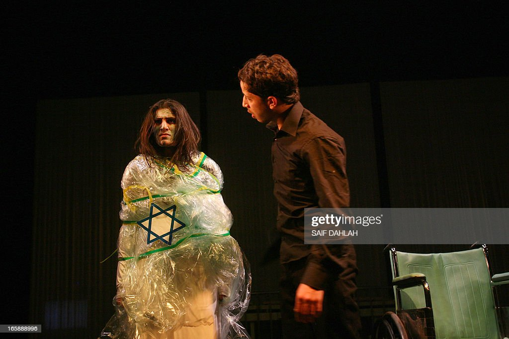 """Palestinian actors of The Freedom Theatre perform in the play 'Suicide Note from Palestine"""" directed by Nabil Al-Raee on April 4, 2013 at The Freedom Theatre in the refugee camp of the West Bank city of Jenin. The play takes place until April 8, 2013, two years after the assassination of the theatre's Israeli-Palestinian director, Juliano Mer-Khamis in the city's refugee camp by an unknown gunman."""