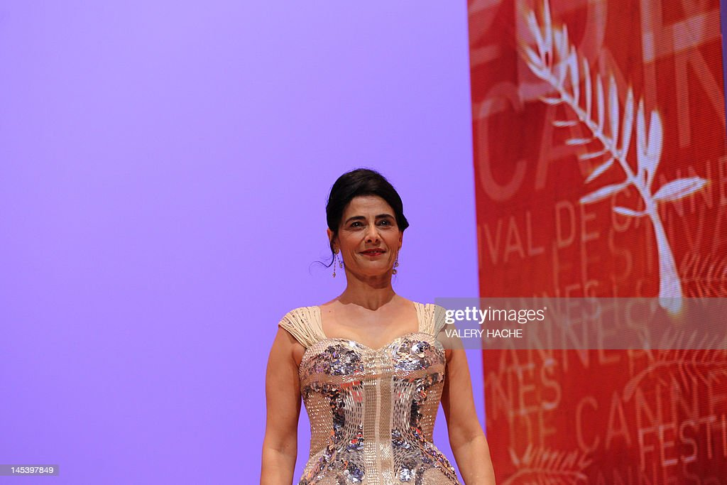 Palestinian actress and director and member of the Jury, Hiam Abbass smiles as she arrives on stage during the closing ceremony of the 65th Cannes film festival on May 27, 2012 in Cannes. AFP PHOTO / VALERY HACHE