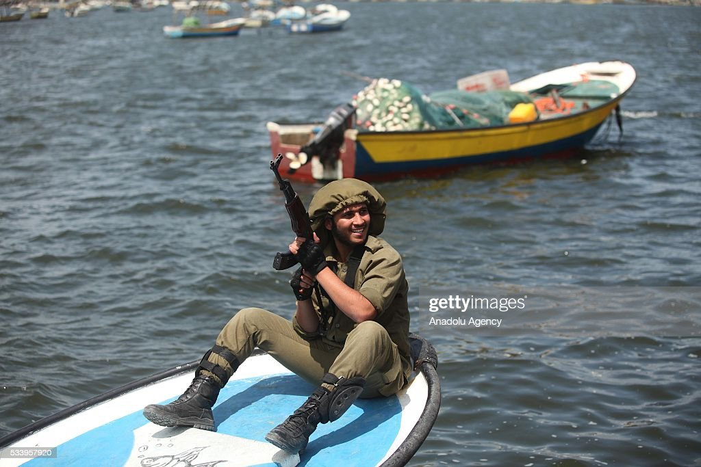 A Palestinian acts out representatively the violation of Israeli Security forces in the sea during a demonstration demanding lifting the blockade of Israel in Gaza City, Gaza on May 24, 2016.
