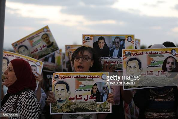 Palestinian and ArabIsraeli protestors hold posters against administrative detention and in support of Palestinian prisoner Bilal Kayed who has been...