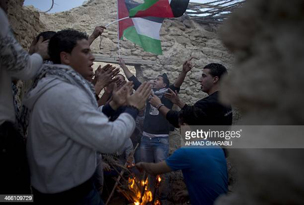 Palestinian and foreign activists gather in an abandoned house near Jericho in the occupied West Bank on January 31 during a protest denouncing the...