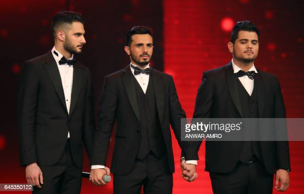 Palestinian Arab Idol TV show winners Yaacoub Shahin Ammar Mohammed and Amir Dandan stand on stage during the final in the panArab song contest on...