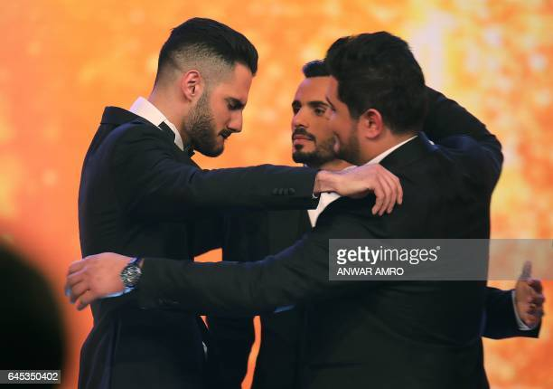 Palestinian Arab Idol TV show winners Yaacoub Shahin Ammar Mohammed and Amir Dandan celebrate on stage during the final in the panArab song contest...