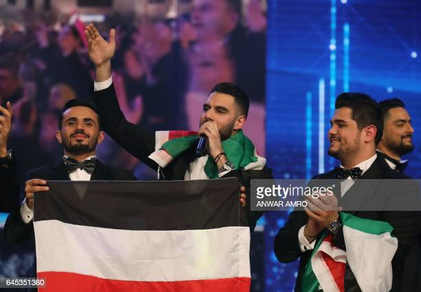 Palestinian Arab Idol TV show winners Yaacoub Shahin Ammar Mohammed and Amir Dandan standing on stage during the final in the panArab song contest on...