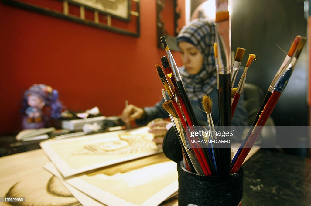 Palestinian artist Salwa Sbakhi paints using coffee at her studio in Gaza City on January 13, 2013. Salwa, who lives in the southern Gaza Strip, has studied fine arts at Al-Aqsa University in Gaza, and participated in numerous local exhibitions in an attempt to market her art.