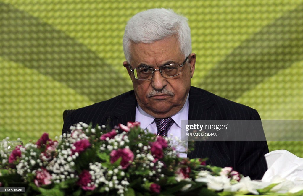 Palestinian Authority president and head of the Fatah movement Mahmud Abbas attends a Fatah 'Revolutionary Council' meeting in the Palestinian West Bank city of Ramallah along with top officials, on December 26, 2012. AFP PHOTO / ABBAS MOMANI