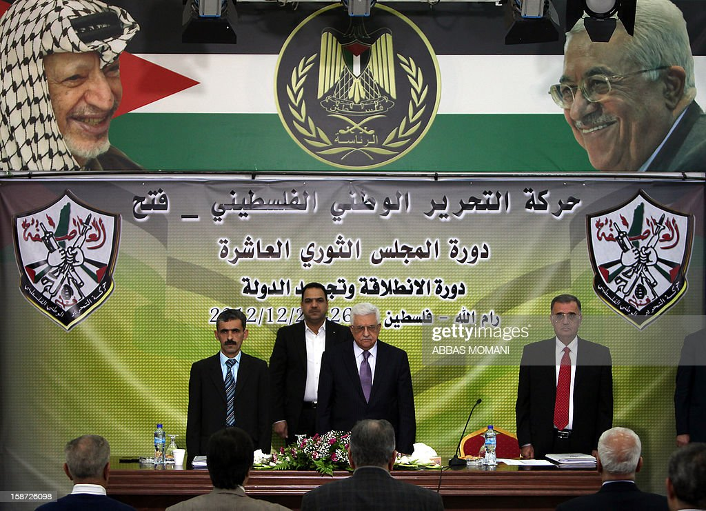 Palestinian Authority president and head of the Fatah movement Mahmud Abbas (C) arrives to attend a Fatah 'Revolutionary Council' meeting in the Palestinian West Bank city of Ramallah along with top officials, on December 26, 2012.