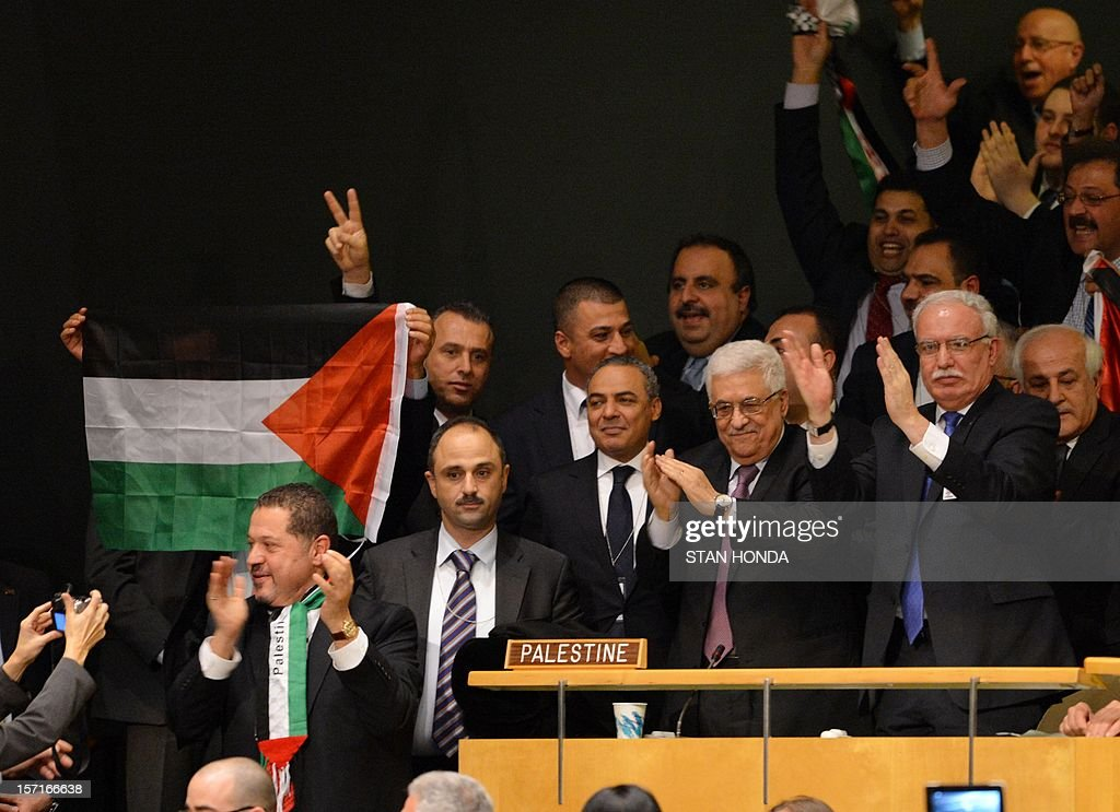 Palestinian Authority President Mahmoud Abbas (2nd R) and the delegation celebrate after the United Nations General Assembly voted to approve a resolution to upgrade the status of the Palestinian Authority to a nonmember observer state November 29, 2012 at UN headquarters in New York. AFP PHOTO/Stan HONDA