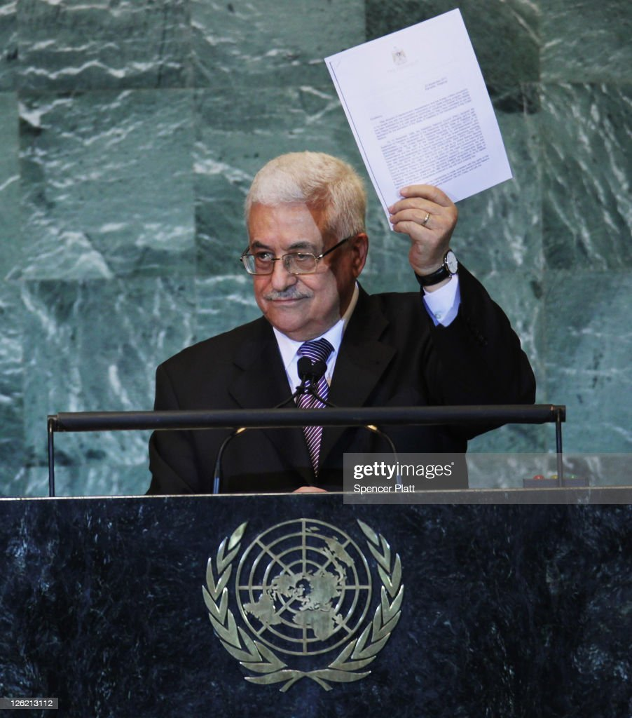 Palestinian Authority President <a gi-track='captionPersonalityLinkClicked' href=/galleries/search?phrase=Mahmoud+Abbas&family=editorial&specificpeople=176534 ng-click='$event.stopPropagation()'>Mahmoud Abbas</a> holds up papers for statehood while addressing the United Nations General Assembly on September 23, 2011 in New York City. The annual event, which is being dominated this year by the Palestinian's bid for full membership, gathers more than 100 heads of state and government for high level meetings on nuclear safety, regional conflicts, health and nutrition and environment issues.