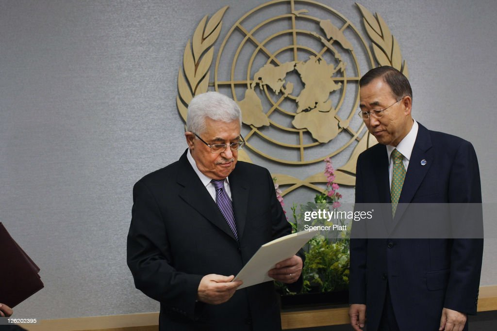 Palestinian Authority President <a gi-track='captionPersonalityLinkClicked' href=/galleries/search?phrase=Mahmoud+Abbas&family=editorial&specificpeople=176534 ng-click='$event.stopPropagation()'>Mahmoud Abbas</a> (L) pauses before formally submiting papers for statehood to United Nations Secretary-General Ban Ki-moon during the UN General Assembly on September 23, 2011 in New York City. The annual event, which is being dominated this year by the Palestinian's bid for full membership, gathers more than 100 heads of state and government for high level meetings on nuclear safety, regional conflicts, health and nutrition and environment issues.