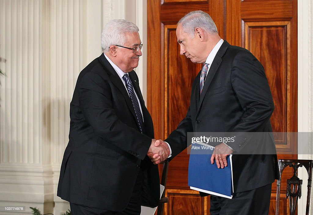 Palestinian Authority President <a gi-track='captionPersonalityLinkClicked' href=/galleries/search?phrase=Mahmoud+Abbas&family=editorial&specificpeople=176534 ng-click='$event.stopPropagation()'>Mahmoud Abbas</a> (L) shakes hands with Israeli Prime Minister <a gi-track='captionPersonalityLinkClicked' href=/galleries/search?phrase=Benjamin+Netanyahu&family=editorial&specificpeople=118594 ng-click='$event.stopPropagation()'>Benjamin Netanyahu</a> (R) during an East Room statement at the White House on the first day of the Middle East peace talks September 1, 2010 in Washington, DC. The White House has kicked off a new round of direct peace talks for the Middle East, the first one in more than 18 months.
