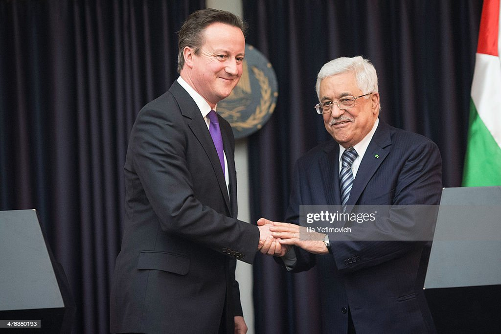 Palestinian Authority President Mahmoud Abbas shakes hands with British Prime Minister David Cameron during an official visit on March 13 2014 in...