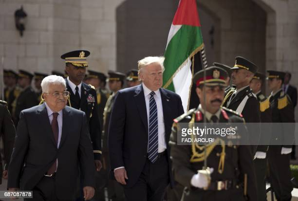 Palestinian Authority President Mahmud Abbas and US President Donald Trump are seen during a welcome ceremony at the Presidential Palace in Bethlehem...