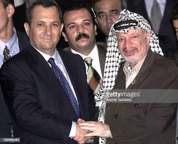 Palestinian Authority President Yasser Arafat shakes hands with Israeli Prime Minister Ehud Barak before their joint second working meeting at the...