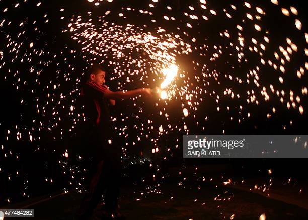 A Palestinian boy celebrates with fireworks during the Muslim holy month of Ramadan in Rafah in the southern Gaza Strip as the faithful prepare for...