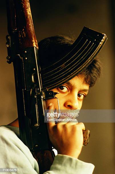 Palestinian boy fighter with his AK47 inside the beseiged Bourj AlBarajneh refugee camp in Beirut