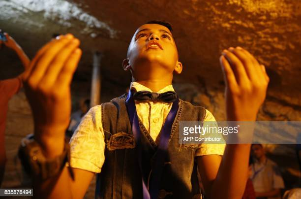 A Palestinian boy from the Gaza Strip prays inside the Dome of the Rock mosque in the AlAqsa mosque compound in Jerusalem's old city on August 20...