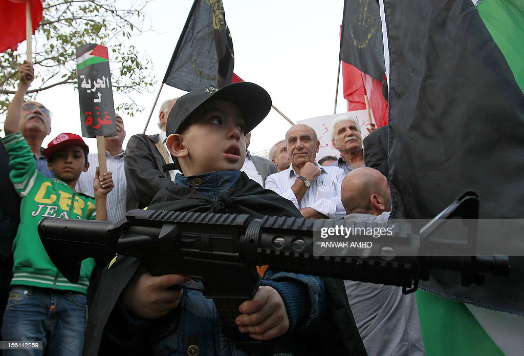 A Palestinian boy holds a toy gun during a demonstration in Beirut on November 15, 2012, protesting against the Israel's ongoing military operation in the Gaza Strip. Israel carried out 24 hours of air strikes on Gaza, killing several Palestinians, including Hamas militants.