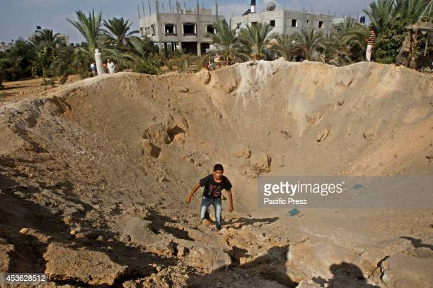 Palestinian boy inspects the damage of an Israeli air strike in some parts of Khan Younis in the Southern of Gaza City According to the Palestinians...