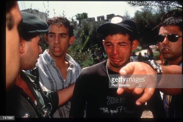 Palestinian boy is arrested by Israeli police July 15 1997 in Jerusalem Israel Jerusalem the capital of Israel and a holy city for three major world...