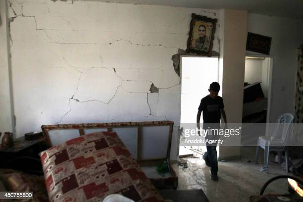 Palestinian boy looks at the mess in their bedroom at the Balata Camp Nablus West Bank on June 17 2014 Israeli soldiers patrol to search three young...