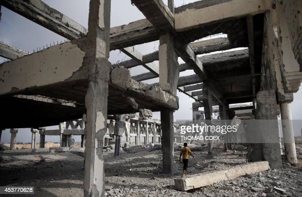 A Palestinian boy makes his way through the rubble of the destroyed and deserted terminal of the Gaza strips former international airport in the...