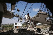 A Palestinian boy plays in the rubble of houses destroyed during the 50day war between Israel and Hamas militants in the summer of 2014 in the...