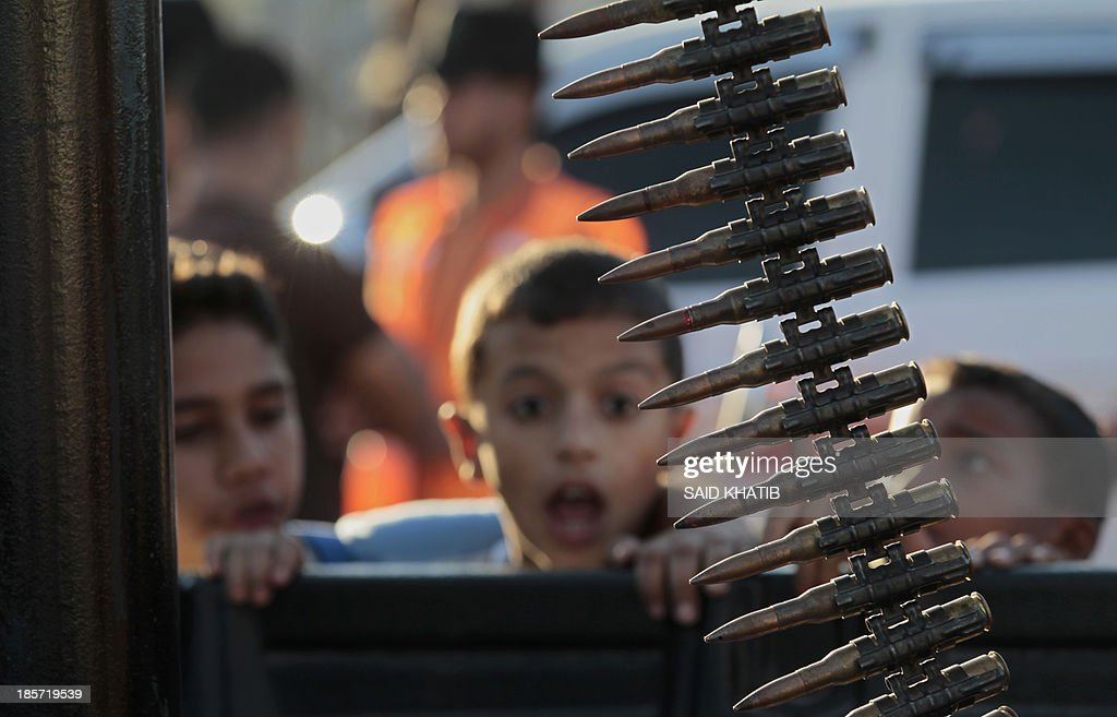 A Palestinian boy reacts as he attends a rally of the Islamic Jihad militants against Israel in the southern Gaza Strip town of Rafah, on October 24, 2013.