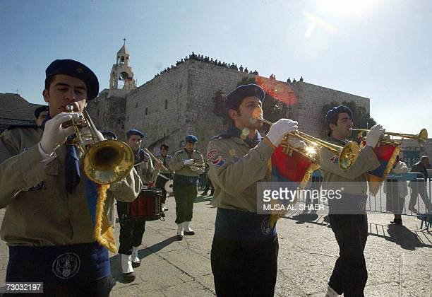 Palestinian boy scouts play in their brass band outside the Church of the Nativity in Manger Square as Armenian Orthodox Christians begin to...